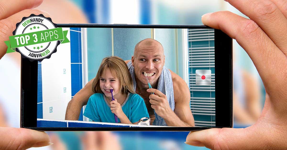 Zahnputz-Apps: Handybildschirm mit Vater und Tochter, die Zähne putzen