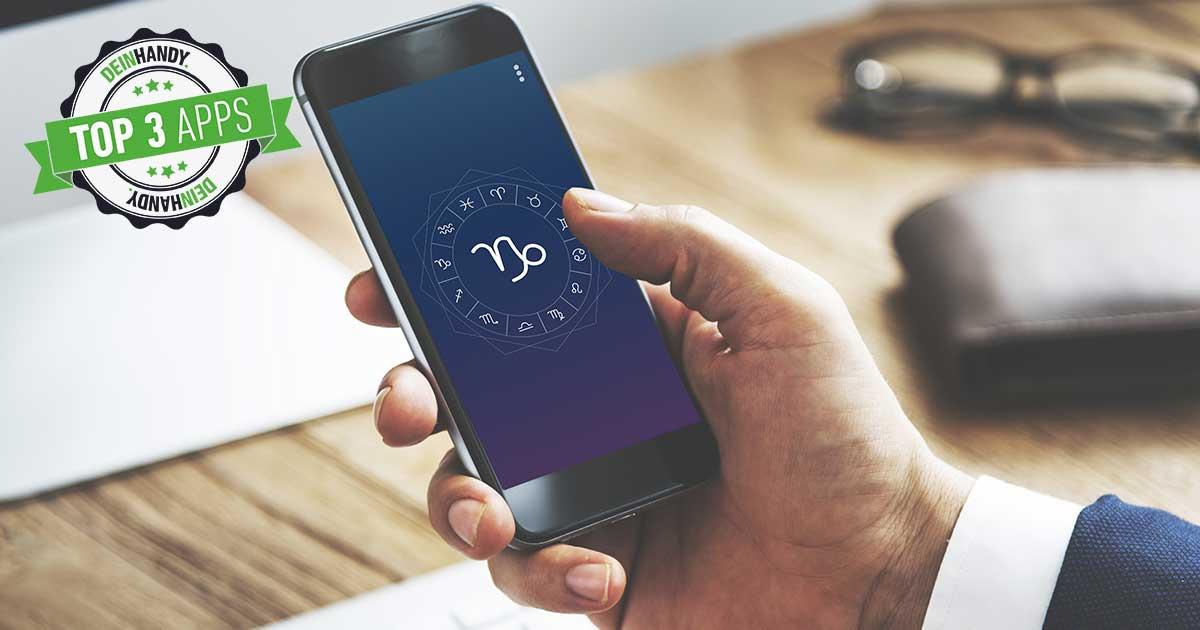 Horoskop-Apps: Handy mit Horoskop wird von Hand gehalten