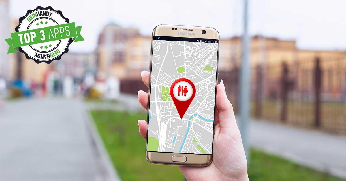 Toiletten Finder: Handy mit Handy in der Smartphone, im Bildschirm ein Toiletten Zeichen