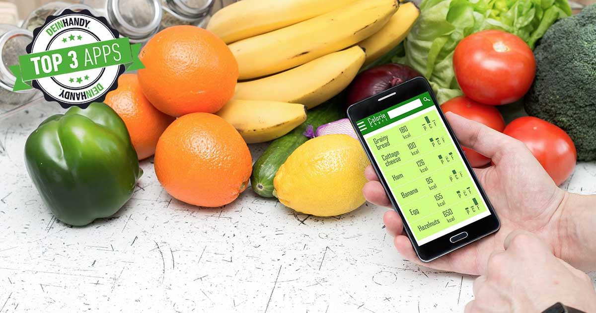 Abnehm-Apps: Handy mit Smartphone, im Hintergrund Obst und Gemüse