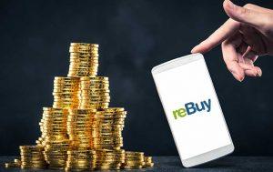 Wir kaufen Dein Handy: Geldmünzen und daneben ein Handy mit reBuy Logo im Display