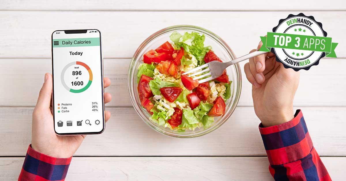 Kalorienzähler-Apps: Handy und Salat auf einem Tisch
