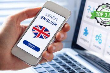 """Vokabeltrainer-App: Handy mit """"Learn Englisch"""" auf dem Display, im Hintergrund ein PC"""