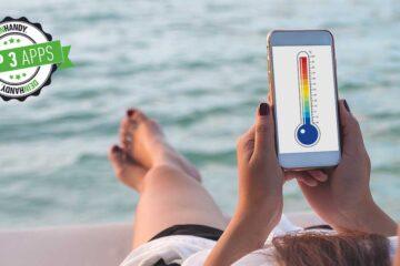 Thermometer-App: Frau mit Handy in der Hand am Meer