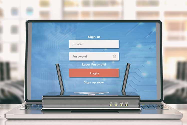 Laptop mit Anmeldemaske und Router