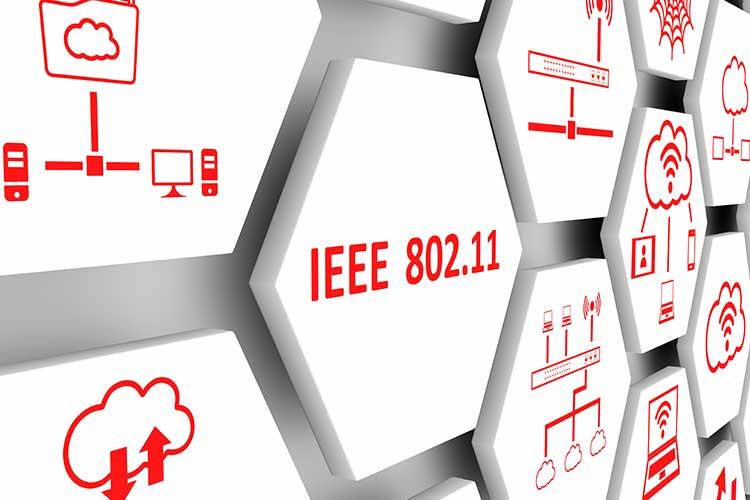 """IEEE 802.15.4: Roter Schriftzug """"IEEE 802.11"""" auf weißem Sechseck"""
